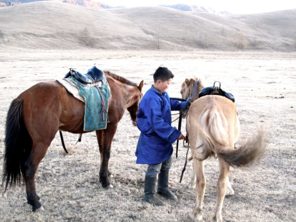 A local boy helped prepared a horse for me. I taught him Alicia Keys' No One in return.